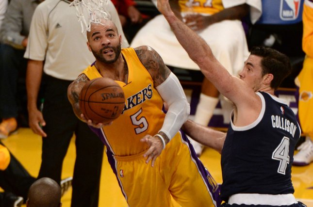 Los Angeles Lakers center Carlos Boozer shoots under Oklahoma City Thunder center Nick Collison during the first half of their NBA game at Staples Center in Los Angeles, November 19, 2014. The Thunder defeated the Lakers 104-103. UPI/Jon SooHoo