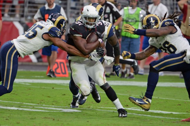 Arizona Cardinals' David Johnson (C) leads the NFL with 510 scrimmage yards. He is the first player in franchise history to record at least 100 scrimmage yards in each of first four games of a season.