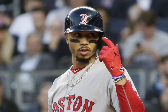 Boston Red Sox's Mookie Betts reacts after almost being hit by a pitch in the 2nd inning against the New York Yankees on May 9 at Yankee Stadium in New York City. Photo by John Angelillo/UPI