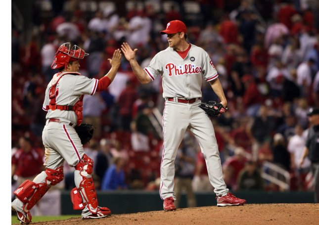 Philadelphia Phillies pitcher Brad Lidge (R) is congratulated by catcher Carlos Ruiz after getting the third out and defeating the St. Louis Cardinals 10-7 at Busch Stadium in St. Louis on May 5, 2009. (UPI Photo/Bill Greenblatt)