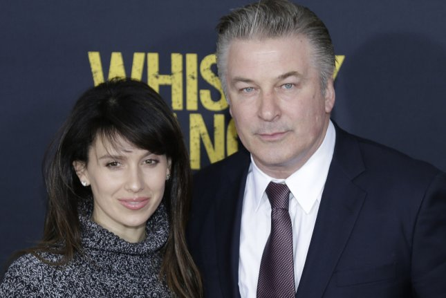 Alec Baldwin (R) and wife Hilaria Baldwin at the New York premiere of Whiskey Tango Foxtrot on March 1. The actor will host a Match Game revival. File Photo by John Angelillo/UPI