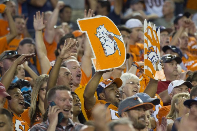 Fans celebrate Denver Broncos defense against the Carolina Panthers during the fourth quarter at the NFL's season opener and Super Bowl 50 rematch at Sports Authority Field at Mile High in Denver on September 8, 2016. Denver beat Carolina 21-20. Photo by Gary C. Caskey/UPI