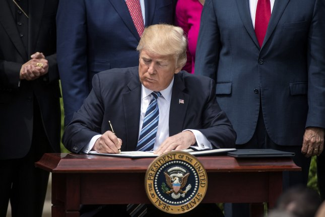 Trump signs executive order to prevent computer hacking