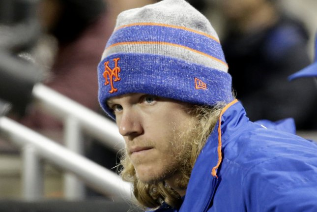 New York Mets pitcher Noah Syndergaard had some help at the plate on Sunday, hitting a homer against the St.Louis Cardinals in a game at Busch Stadium, a homer that was helped out by Cardinals center fielder Dexter Fowler. File Photo by John Angelillo/UPI