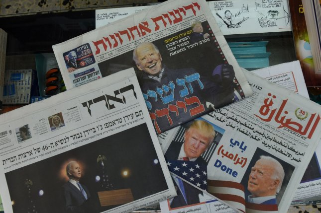 The front pages of Israeli Hebrew and Palestinian Arabic newspapers announce the election of U.S. President-elect Joe Biden. Photo by Debbie Hill/UPI