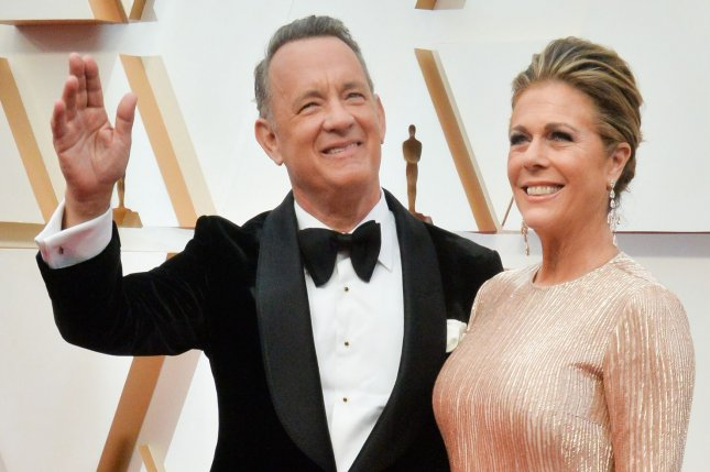 Tom Hanks (L) and his wife Rita Wilson arrive for the 92nd annual Academy Awards on February 2020. Hanks is hosting Celebrating America special, which will also feature John Legend and Demi Lovato. File Photo by Jim Ruymen/UPI