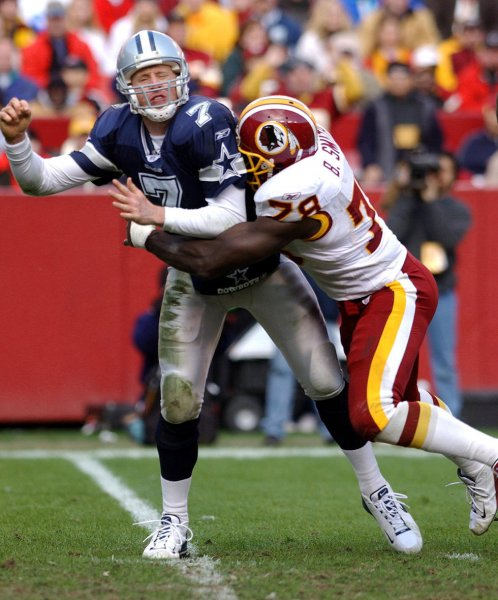 LAN2002122910 - LANDOVER, Md., Dec. 29 (UPI) -- Dallas Cowboys quarterback Chad Hutchinson loses the ball as he is hit by Washington Redskins defensive end Bruce Smith, resulting in a Redskins touchdown, on Dec. 29, 2002, at FedEx Field in Landover, Md.. The Redskins beat the Cowboys 20-14, after losing 10 straight games to their rival. jg/rlw/Roger L. Wollenberg UPI