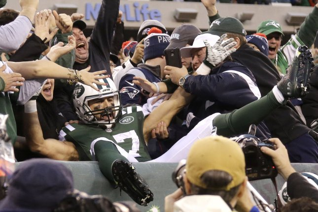 New York Jets receiver Eric Decker leaps into the seats and celebrates with  the fans after catching a 6-yard game-winning touchdown pass in overtime  against ... e360c2c07