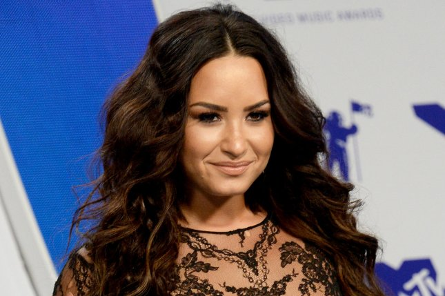 Demi Lovato attends the MTV Video Music Awards on August 27. The singer reacted Wednesday to a Twitter user who criticized her for refusing to label her sexual orientation. File Photo by Jim Ruymen/UPI