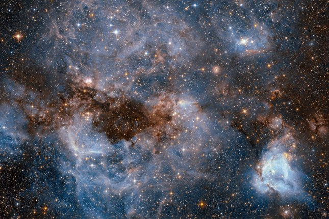 New research suggests atomic hydrogen is just as important and abundant as molecular hydrogen in young galaxies with intense rates of star formation. Photo by NASA/UPI