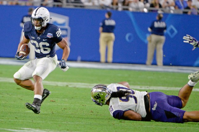 Penn State Nittany Lions running back Saquon Barkley (L) avoids the attempted tackle by Washington Huskies defender Vita Vea in the fourth quarter of the Play Station Fiesta Bowl on December 30, 2017 at University of Phoenix Stadium in Glendale, Arizona. File photo by Art Foxall/UPI