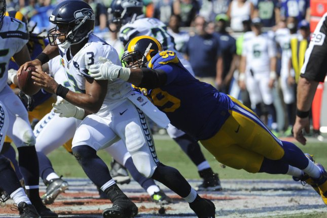 Los Angeles Rams defensive tackle Aaron Donald tackles Seattle Seahawks quarterback Russell Wilson in the first half on October 8 at the Memorial Coliseum in Los Angeles. Photo by Lori Shepler/UPI
