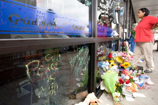 Fans gather to mourn the death of former Tennessee Titans quarterback Steve McNair outside his Gridiron 9 restaurant in Nashville, Tennessee on July 6, 2009. McNair was found dead with several gunshot wounds in a Nashville condominium on Saturday, July 4. (UPI Photo/Frederick Breedon IV)