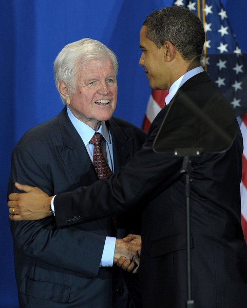 U.S. President Barack Obama shakes hands with Sen. Edward Kennedy, D-MA, before signing the Edward M. Kennedy Serve America Act at the SEED Public Charter School on April 21, 2009. Obama called on Americans to serve their communities and work together to tackle tough challenges. (UPI Photo/Roger L. Wollenberg)