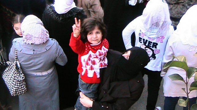 Women protest against the government in the Al-qsoor neighborhood of Homs, Syria, on March 19, 2012. UPI