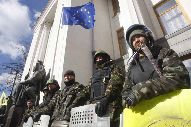 Ukrainian self defense volunteers stand outside the parliament building in Kiev on March 17, 2014 a after the referendum on independence in Crimea. UPI/Ivan Vakolenko