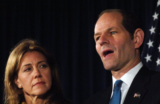 Former NYS Gov. Eliot Spitzer has until Thursday to get on NYC ballot. Silda Wall Spitzer (L), wife of New York Governor Eliot Spitzer (R), looks on while her husband announced his resignation from office at a press conference in New York on March 12, 2008. Spitzer's resignation, after revelation of his involvement with a prostitution ring, was effective on March 17, 2008. (UPI Photo/Ezio Petersen)