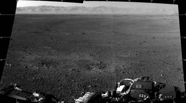 This NASA image composition taken on August 6, 2012 is the first two full-resolution image set of the Martian surface from the Navigation cameras on NASA's Curiosity rover, which are located on the rover's head or mast. The rim of Gale Crater can be seen in the distance beyond the pebbly ground. Curiosity, which successfully landed on the Martian surface on August 6, 2012, is NASA's newest Martian rover equipped with a host of sensors and cameras with the mission goal to assess whether Mars ever was, or is still, an environment able to support microbial life. UPI/NASA/JPL-Caltech/MSSS