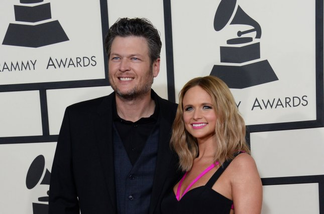 Miranda Lambert, right, and Blake Shelton at the Grammy Awards on Feb. 8. The country star opened up about her divorce in the January issue of Cosmopolitan. File Photo by Jim Ruymen/UPI