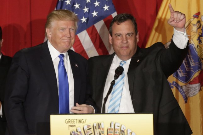 Presumptive Republican presidential nominee Donald Trump, left, and New Jersey Gov. Chris Christie stand on stage together at a fundraiser at the Lawrenceville National Guard Armory on Thursday in Lawrence Township, N.J. Trump and Christie headlined the $200-per-person fundraiser to pay down Christie's roughly $250,000 presidential campaign debt. Photo by John Angelillo/UPI