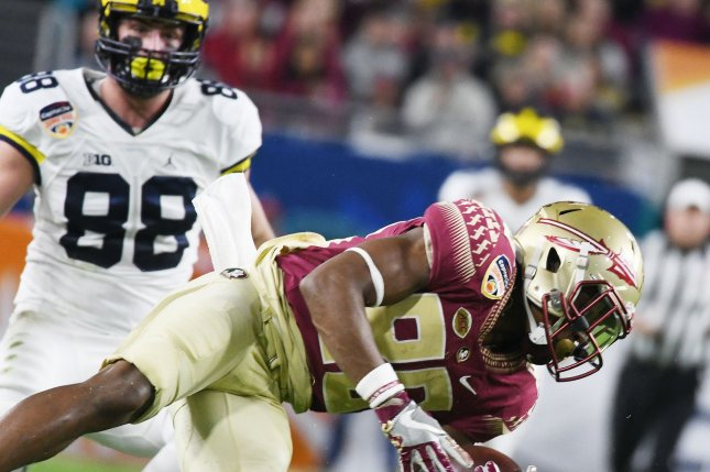 Florida State Seminoles Nyqwan Murray rushes against Michigan Wolverines in the second quarter of the 2016 Capital One Orange Bowl at Hard Rock Stadium in Miami Gardens, Florida on December 30, 2016. Photo by Gary Rothstein/UPI