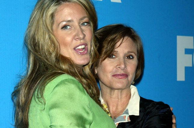 Carrie Fisher (right) of On the Lot poses with her sister Joely Fisher of 'til Death at the Fox 2007 Programming Presentation at Wollman Rink in Central Park in New York on May 17, 2007. File Photo by Laura Cavanaugh/UPI