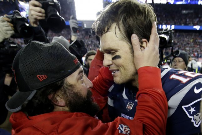 New England Patriots defensive coordinator Matt Patricia (L) hugs winning Patriots quarterback Tom Brady after beating the Jacksonville Jaguars 24-20 on January 21 in the AFC Championship game at Gillette Stadium in Foxborough, Massachusetts. File photo by John Angelillo/ UPI