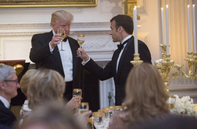 United States President Donald Trump shares a toast with French President Emmanuel Macron during a state dinner for Macron and Brigitte Macron during a visit to The White House Tuesday. Photo by Chris Kleponis/UPI