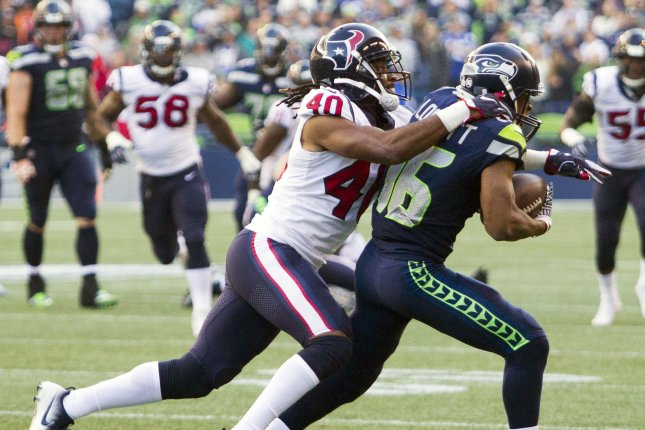 Former Houston Texans cornerback Marcus Williams (40) brings down Seattle Seahawks wide receiver Tyler Lockett (16) after he pulled in a pass for a 16-yard gain in the fourth quarter on October 29, 2017 at CenturyLink Field in Seattle, Washington. Photo by Jim Bryant/UPI