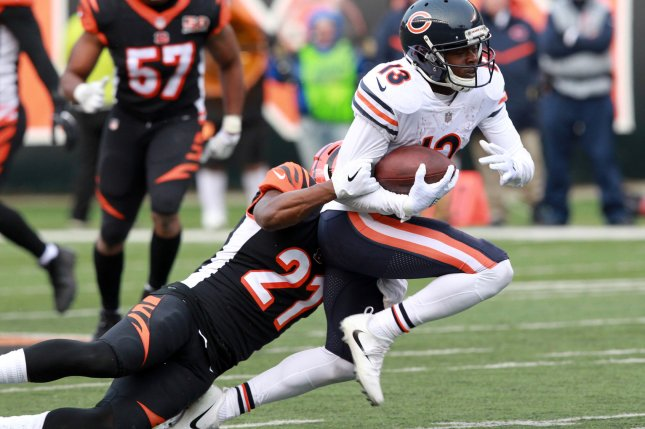 Former Chicago Bears wide receiver Kendall Wright (13) fights to break free from Cincinnati Bengals' Dre Kirkpatrick (27) during the second half of play on December 10 at Paul Brown Stadium in Cincinnati. Photo by John Sommers II/UPI