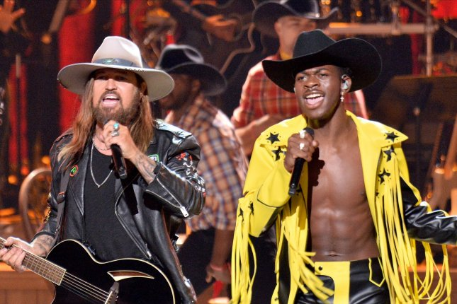 Billy Ray Cyrus (L) and Lil Nas X perform during the 19th annual BET Awards at the Microsoft Theater in Los Angeles on June 23, 2019. Their song, Old Town Road, broke the record for longest No. 1 single on the Billboard 100 on July 29, 2019. File Photo by Jim Ruymen/UPI