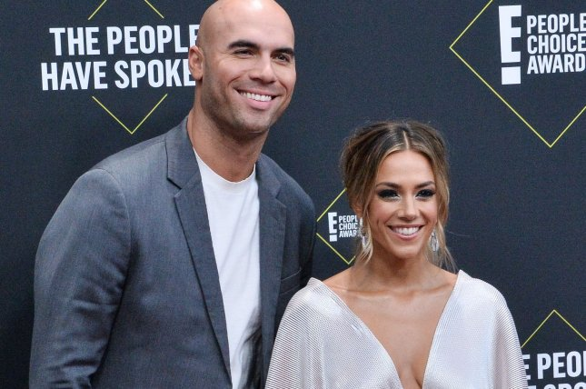 Mike Caussin (L) and Jana Kramer are ending their six-year marriage. File Photo by Jim Ruymen/UPI