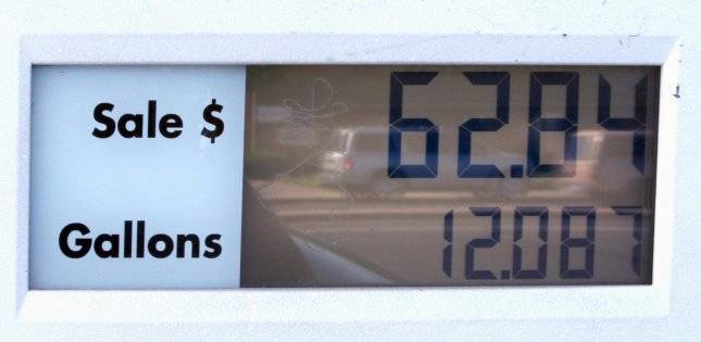 Passing motorists are reflected in the transaction window on a gas pump at a Shell station in Redwood City, California on June 12, 2008. Gas prices are beginning to push $5 a gallon all over the Golden State. (UPI Photo/Terry Schmitt)