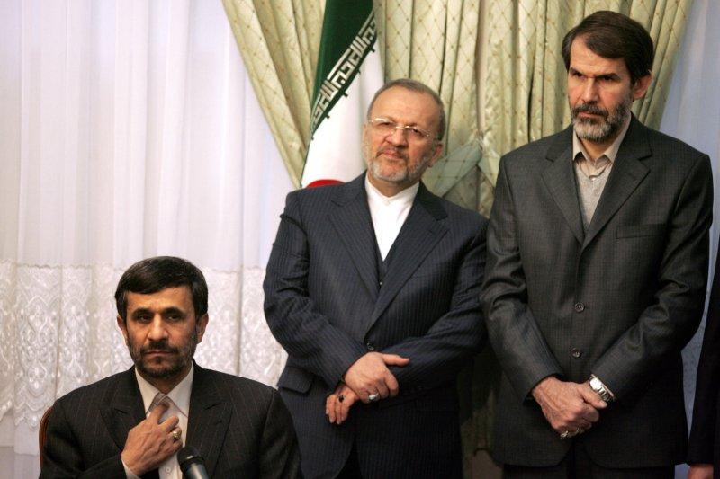 Iran's President Mahmoud Ahmadinejad (L) gestures as Foreign Minister Manouchehr Mottaki (C) and interior minister Seyed Sadegh Mahsooli look on.