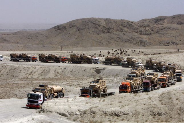 Pakistani trucks carrying NATO and U.S military vehicles cross the Quetta Chaman highway at Kojak Pass border area after leaving the southern Afghanistan province of Kandahar near Chaman, Pakistan on July 25, 2013. The trucks head to the port of Karachi, Pakistan as the pullout continues, ending a NATO/USA decade-long military combat involvement in Afghanistan by the end of 2014. There are approximately 60,000 American troops in Afghanistan at present. UPI/Matiullah Achakzai