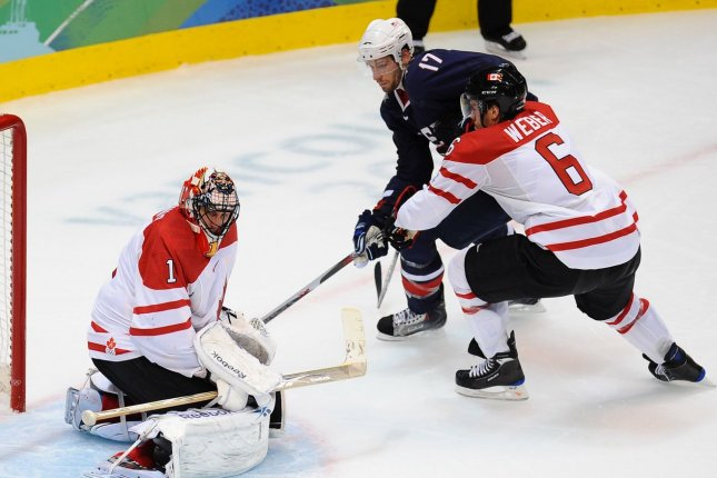 USA's Ryan Kesler tips the puck past Canada's Roberto Luongo as Canada's Shea Weber defends in the second period of the gold medal men's ice hockey game at Canada Hockey Place in Vancouver, Canada, during the 2010 Winter Olympics on February 28, 2010. (File/UPI/Roger L. Wollenberg)