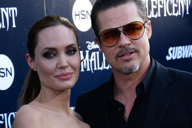 Cast member Angelina Jolie and her longtime partner, actor Brad Pitt attend the premiere of the motion picture fantasy Maleficent at the El Capitan Theatre in the Hollywood section of Los Angeles on May 28, 2014. Maleficent explores the untold story of Disney's most iconic villain from the classic Sleeping Beauty and the elements of her betrayal that ultimately turn her pure heart to stone. Driven by revenge Maleficent cruelly places an irrevocable curse upon the human king's newborn infant Aurora. UPI/Jim Ruymen
