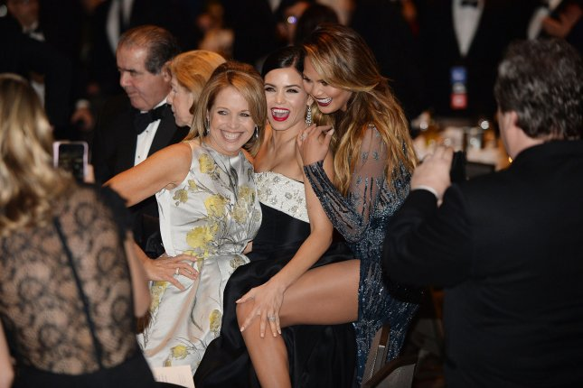 American journalist and author Katie Couric, Jenna Dewan-Tatum and Chrissy Teigen attend the annual White House Correspondent's Association Gala at the Washington Hilton hotel on April 25, 2015 in Washington, D.C. The dinner is an annual event attended by journalists, politicians and celebrities. Pool photo by Olivier Douliery/UPI