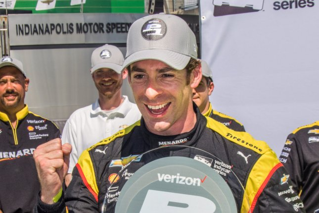 Simon Pagenaud celebrates his winning the pole position during qualifications for the 3rd running of the Grand Prix of Indianapolis at the Indianapolis Motor Speedway on May 13, 2016 in Indianapolis, Indiana. Pagenaud won the race in 2014. Photo by Ed Locke/UPI