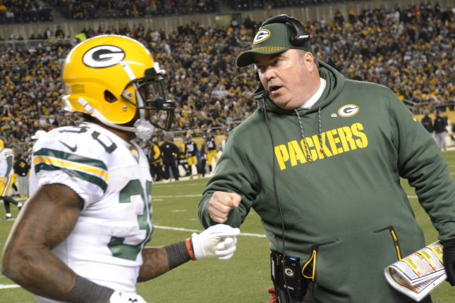 Green Bay Packers head coach Mike McCarthy celebrates the Packers touchdown with Green Bay Packers running back Jamaal Williams (30) at Heinz Field in Pittsburgh on November 26, 2017. File photo by Archie Carpenter/UPI