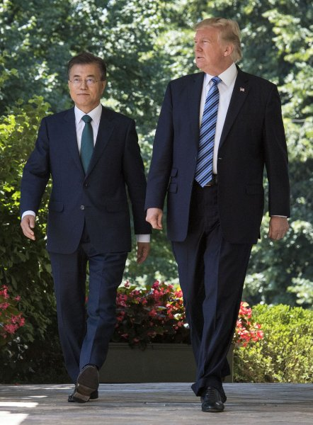 File photo of President Donald Trump (R) and South Korean President Moon Jae-in walking into the Rose Garden tat the White House in Washington, D.C. on June 30, 2017. File photo by Kevin Dietsch/UPI