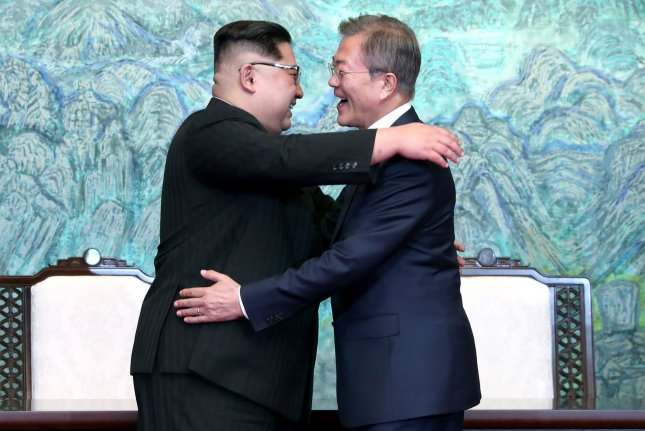 South Korean President Moon Jae-in (R) and North Korean leader Jong Un share a hug after signing the joint Panmunjom Declaration at the Peace House in the border village of Panmunjom in Paju, South Korea, on Friday. Photo by Inter-Korean Summit Press Corps/UPI