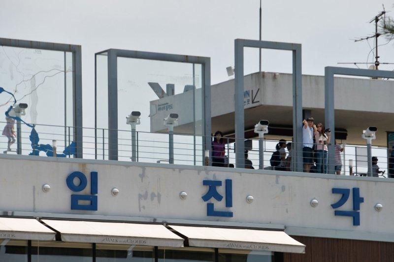 Tourists look toward North Korea from the Imjingak Pavilion near the demilitarized zone in Paju, South Korea. File Photo by Keizo Mori/UPI
