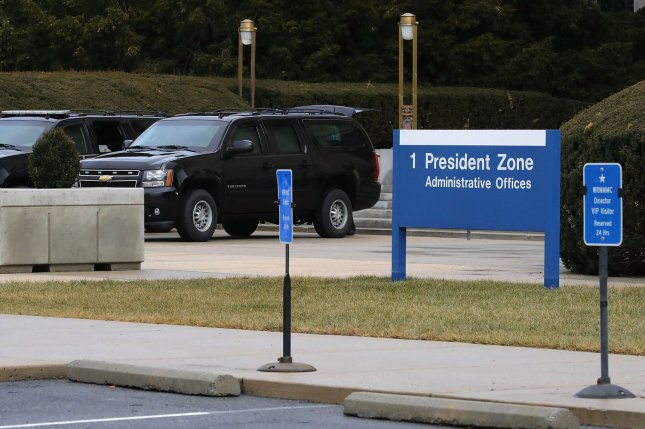 Vehicles from U.S. President Donald Trump's motorcade are seen outside Walter Reed National Military Medical Center in Bethesda, Md. Trump made an unscheduled visit there Saturday. File Photo by Chip Somodevilla/UPI