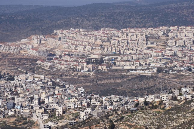 Israeli settlements are seen on the hilltops above the Palestinian village of Jaba in the West Bank on February 13. File Photo by Debbie Hill/UPI