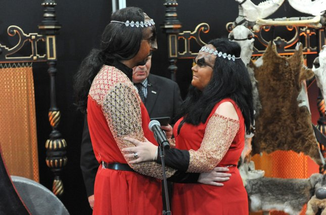 A group has sought permission to review a friend-of-the-court brief regarding a case claiming that the Klingon language from Star Trek is indeed a real language and can't be copyrighted. Jossie Sockertopp and Sonnie Gustavsson, above, of Sweden, were married in full Klingon costume at the first-ever Klingon wedding in the UK. Photo by Paul Treadway/UPI