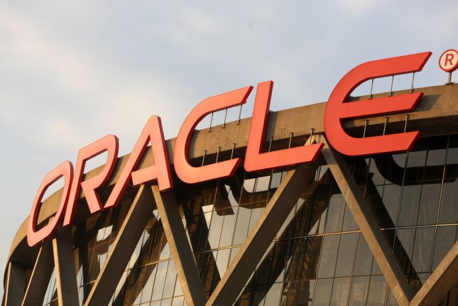 Software and technology giant Oracle, which owns naming rights for the arena of the NBA's Golden State Warriors in Oakland, Calif., pictured, announced Thursday that it had reached an agreement to purchase cloud computing company NetSuite for $9.3 billion and $109 per stock share. Company officials said the deal should close sometime this year after routine regulatory approvals. File Photo by Terry Schmitt/UPI