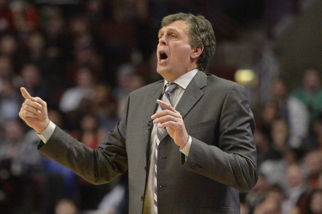 Former Houston Rockets head coach Kevin McHale signals to his former team. File photo by Brian Kersey/UPI