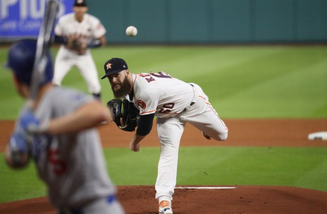 Astros open with victory over Rangers