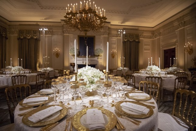 Melania Trump chose a cream and gold color scheme for her first White House state dinner. Photo by Pat Benic/UPI